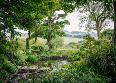 pond and views across The Peak District