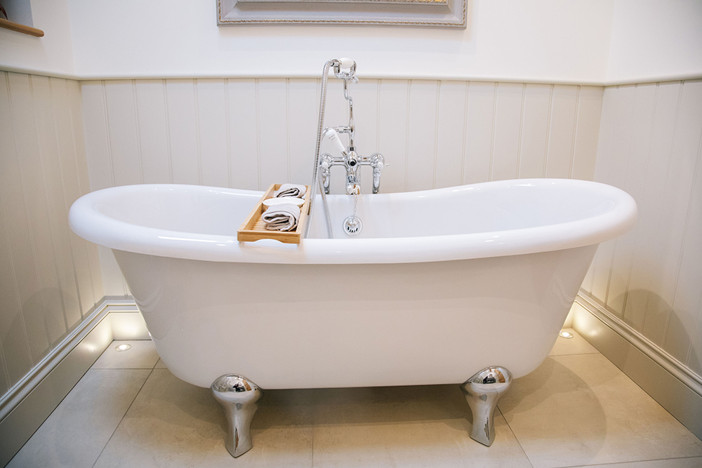 Stand-alone bath in the bathroom in The Cottage