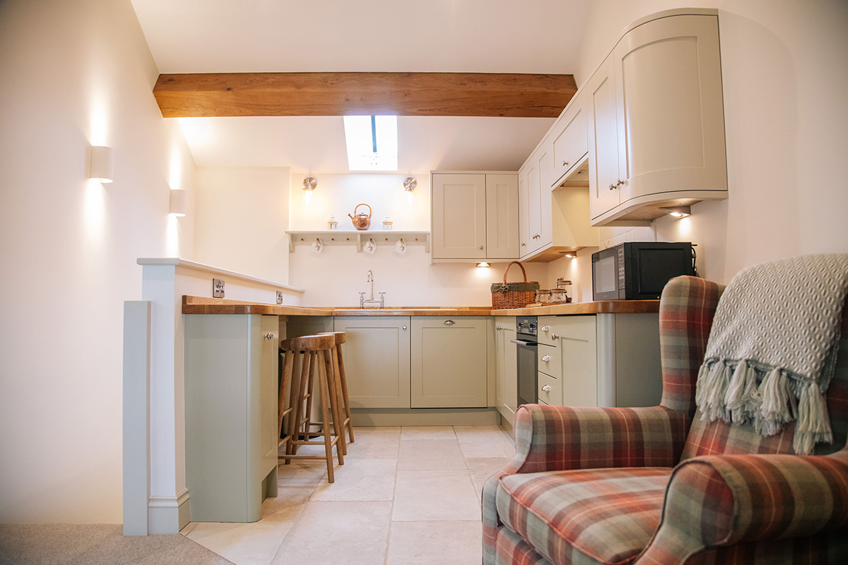 Kitchen and breakfast bar in The Nook at Harrop Farm