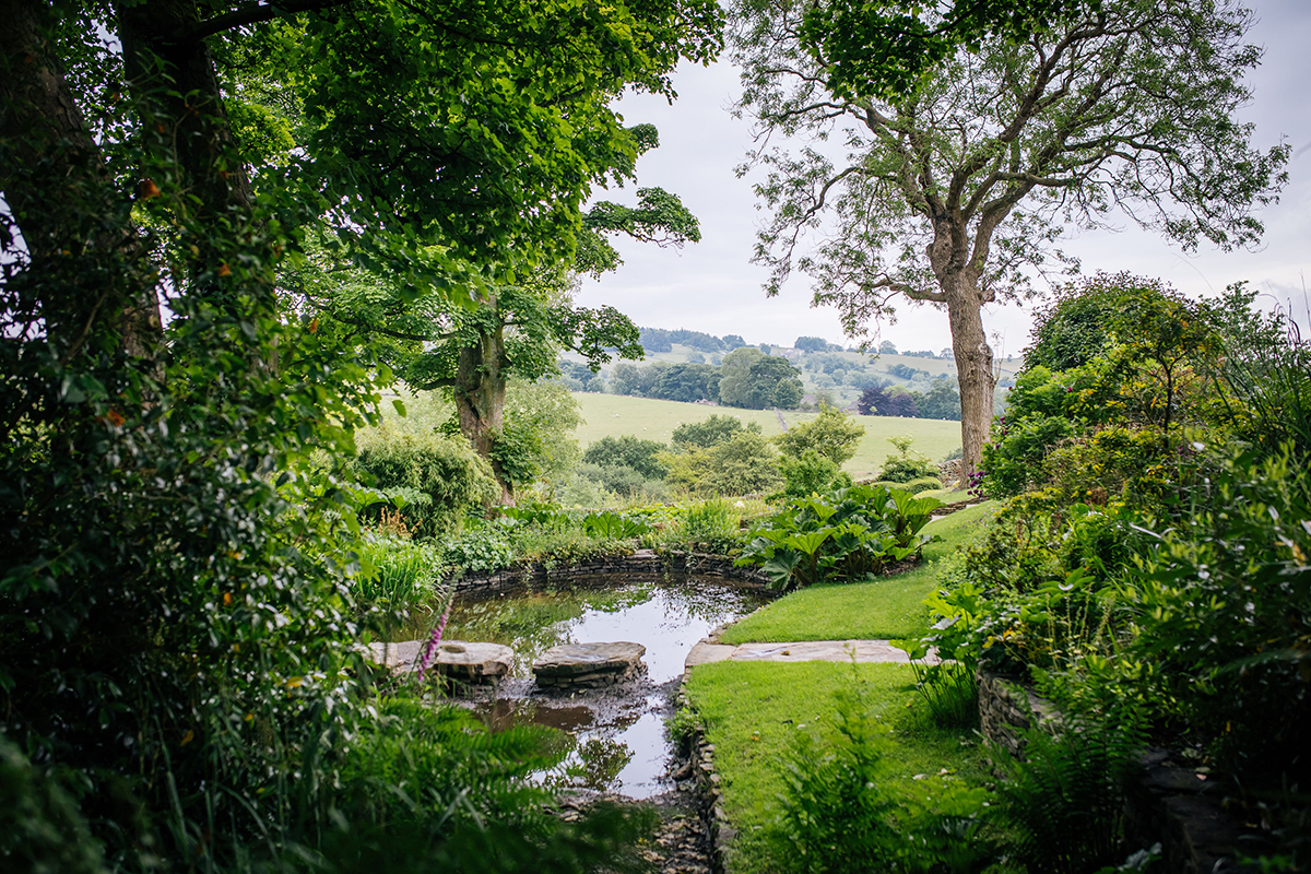 Pond at the bottom of the Harrop Farm garden with views across the Harrop Valley